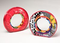 Lifesaver Bracelets constructed from reycled tin cans by Harriete Estel Berman
