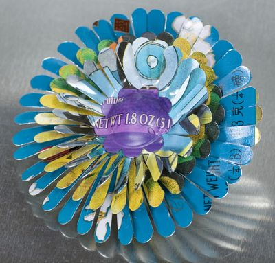 April Flower Brooch Blue and Yellow constructed by Harriete Estel Berma from recycled tin cans in honor of Earth Day
