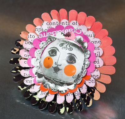 Harriete Estel Berman's April Flower Brooch with pink Cheeks is jewelry constructed from post consumer recycled tin cans.