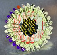 April Flower Nutrition Brooch as a special commission from recycled tin cans by Harriete Estel Berman in honor of Earth Day.