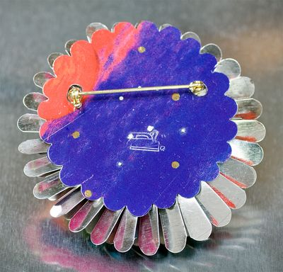 Harriete Estel Berman's April Flower Brooch in Vibrant Colors with Blue and Purple Center