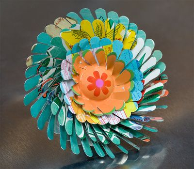 April Flower in Aqua to Jade Green with Orange center by Harriete Estel Berman is constructed from post consumer recycled tin cans in Honor of Earth Day 2010