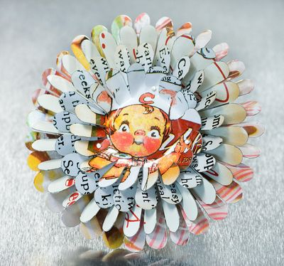 April Flower pin by Harriete Estel Berman is constructed from recycled tin cans.