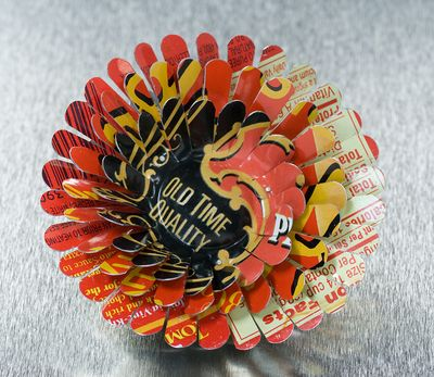 OLD Time Quality April Flower Pin by Harriete Estel Berman is constructed from recycled tin cans.
