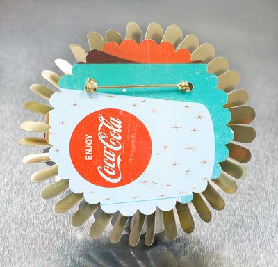 Harriete Estel Berman April Flower Pin with Coke motif really makes your day sparkle.