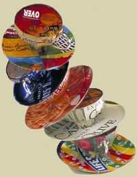 Consuming Conversation R a stack of teacups or coffee cups constructed by Harriete Estel Berman from recycled tin cans