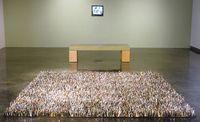 Grass/gras sculpture about our consumer society by Harriete Estel Berman