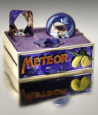 Meteor Fruit Crate and three bracelets by Harriete Estel Berman is constructed from recycled tin cans