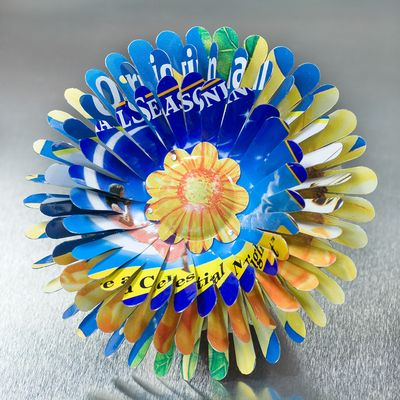 Harriete Estel Berman April Flower in honor of Earth Day in blue Yellow with Celestial Seasoning never stops blooming.
