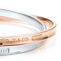 Tiffany bracelets with the Tiffany hallmark on the exterior.