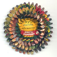 64 Crayola Crayons Flower pin by Harriete Estel Berman is jewelry constructed from recycled materials.