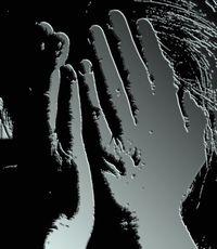 Hands hiding face keeps secrets.