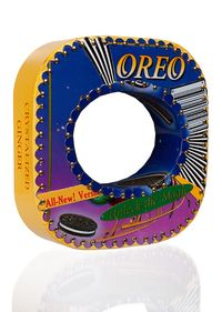 Oreo Cookie Unlock the Magic bracelet by Harriete Estel Berman is constructed from recycled tin cans.