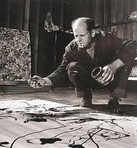 Jackson Pollack painting with a brush upside down