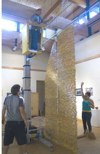 Harriete Estel Berman organizing the installation of Pick Up Your Pencils, BegininstSaysSTOP72.800