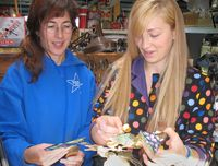 emiko oye and Aryn  Shelander work on the TuBishvat seder plate in progress by Harriete Estel BermanLeaves7457.72800