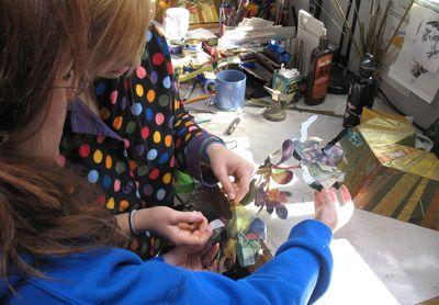 emiko oye and Aryn Shelander working on the TuBishvat seder plate in progress by Harriete Estel BermanAryncloseleaves72.800.7462
