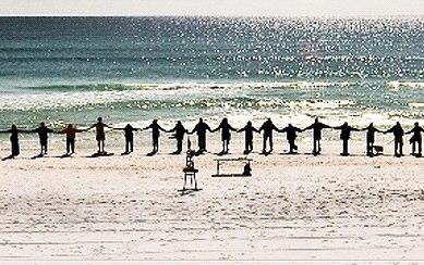 Line in the sand with many hands