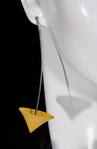 Andy Cooperman earring hanging from a mannequinhanging.spiracles.holes.ear