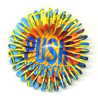 Push Yourself Flower Pin by Harriete Estel Berman constructed from recycled tin cans.