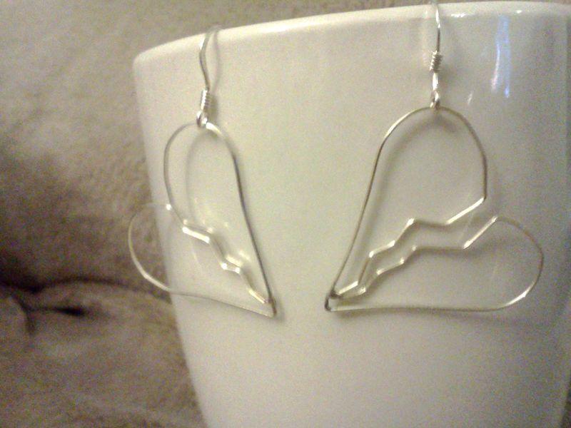 Earrings on teacups