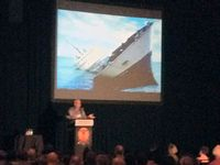 Garth Clark speaking in front of a Sinking Ship