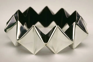 Merry Renk Folded Crown