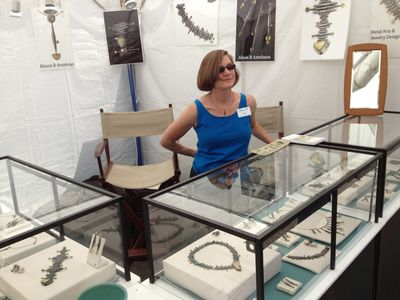 Alison in booth at main st fort worth arts festival