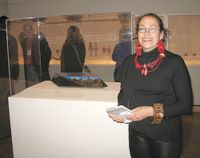 Harriete Estel Berman standing in front of her  artwork on display at the Minneapolis Institute of Artshe Ma