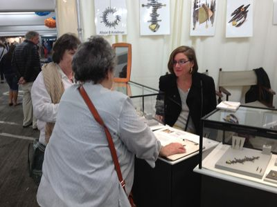 Alison Antelman in her booth at a craft show.