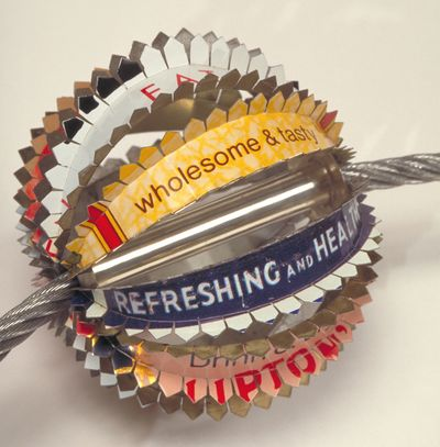 1 Worry Bead by Harriete Estel Berman is made from recycled chocolate tin cans.ny