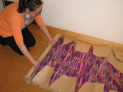 Harriete Estel Berman rolling up pencils for safe shipping of artwork Pick Up Your Pencils Begin