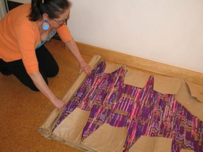 Harriete Estel Berman rolling up pencils for safe shipping of artwork Pick Up Your Pencils Begin