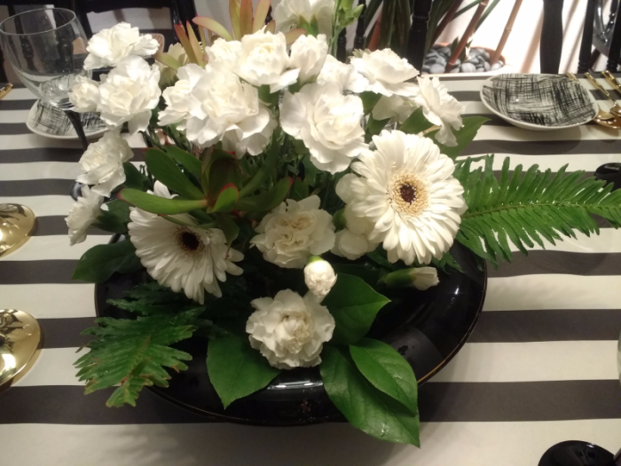 Black and White flowers arrangement with whtie carnations, gerbena daisies with black center, and white roses