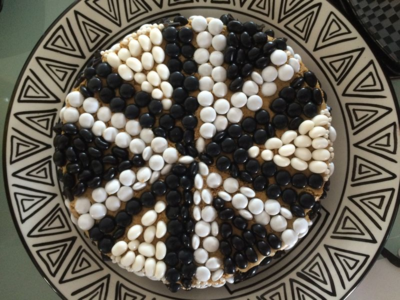 black and white decorations on Pumpkin Cheesecake