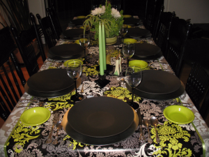 Black, chartreuse green, and gray for a Thanksgiving table motif.