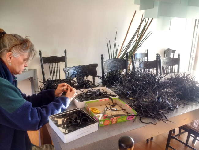 Margot Plageman assembling the Black Plastic Gyre Necklace