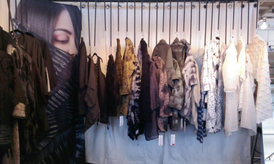 Display of artist made clothing by Amy Nguyen uses a custom designed display.