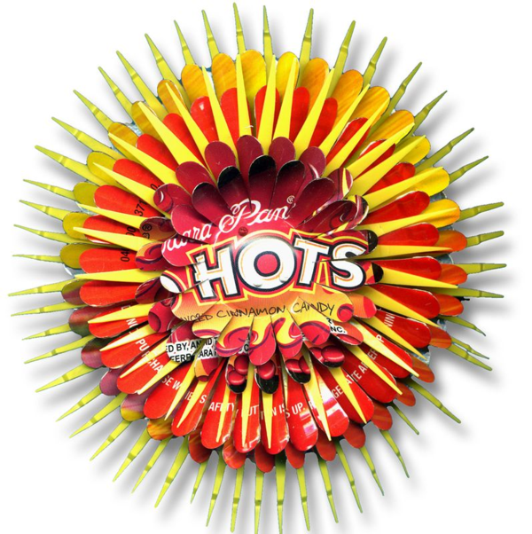 Red Hots Flower Pin by Harriete Estel Berman in yellow and red recycled materials.