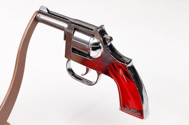 Checking-cost-gun-violence-gun