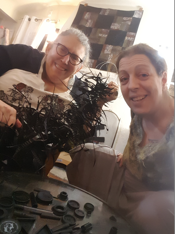 Shoshana Phoenix and Aliza Abrams assembling black plastic
