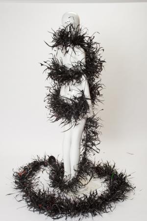 Black Plastic Gyre Necklace Boa shown on a mannequin