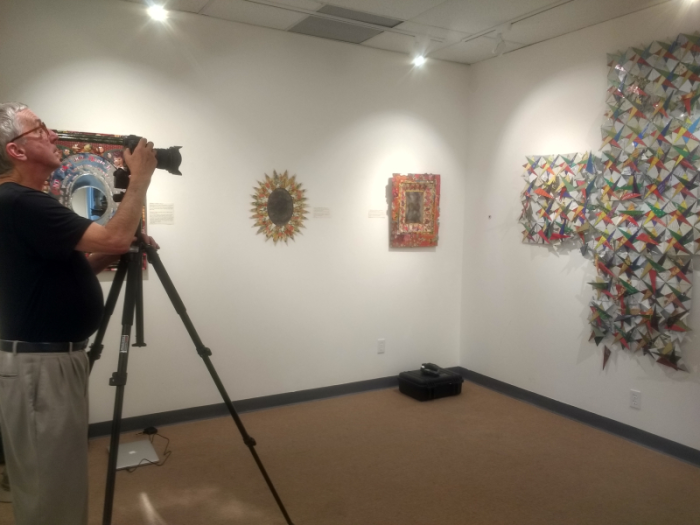 Peninsula Museum of Art photographing work installed in the exhibition