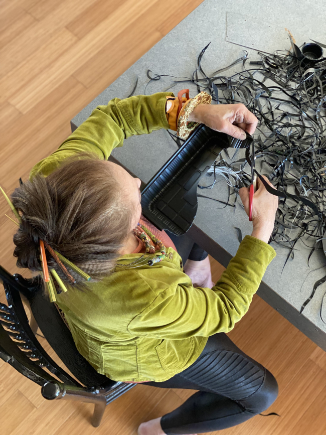 Harriete-studio-cutting-black-plastic-down