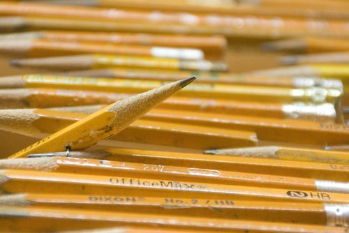 Pencils make a point in the bell curve titled: Pick Up Your Pencils, Begin.
